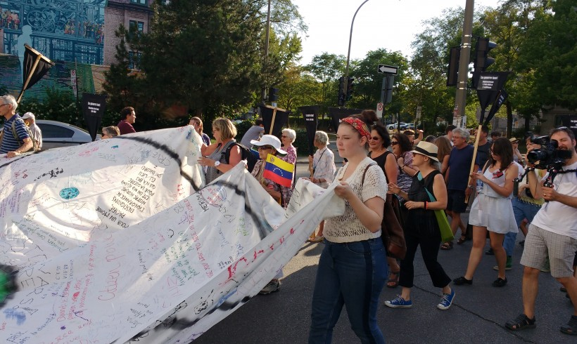 Le Collectif Échec à la guerre durant la marche d'ouverture du Forum social mondial le 9 août 2016. Crédit photo: Mercédez Roberge.